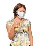 Girl in a medical mask and headset Stock Images