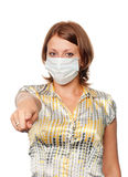 Girl in a medical mask points a finger Stock Images