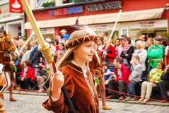 A girl in medieval costume carries a torch Royalty Free Stock Image