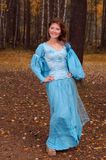 Girl in medieval dress in autumn wood Royalty Free Stock Photos