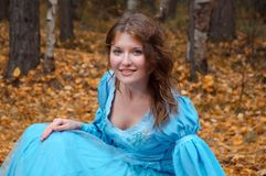 Girl in medieval dress in autumn wood Stock Images