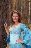 Girl in medieval dress in autumn wood Stock Photos