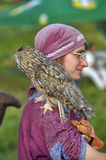 Girl in medieval dress with owl on shoulder Royalty Free Stock Image