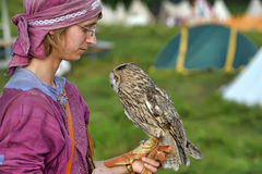Girl in medieval dress with owl on shoulder Royalty Free Stock Photo