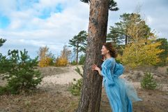 Girl in medieval dress. strong wind Stock Photos