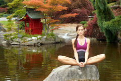Sensual Woman Meditates Rock Pagoda Pond Royalty Free Stock Images