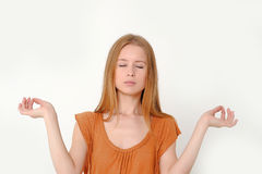 Girl meditates Stock Images