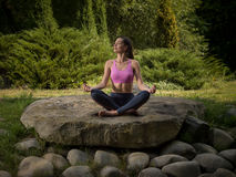 Girl meditates in the lotus position. Royalty Free Stock Photos