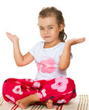The girl meditates on the Mat Stock Image