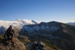 Girl meditates in the mountains. Stock Photos