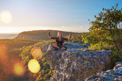 Girl meditates. The girl meditates in mountains of Ukraine Stock Photo
