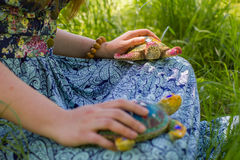 Girl meditates on the nature with the turtles Royalty Free Stock Image
