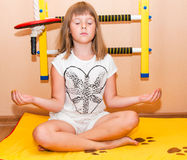 Girl meditates near home sport complex Royalty Free Stock Photos