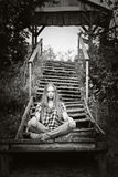 Girl meditates on the steps Royalty Free Stock Photos