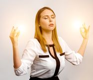 Girl meditates on the work. The girl meditates on the work and producing energy Royalty Free Stock Image
