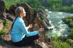 The girl meditating Stock Image