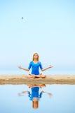 Girl meditating on beach Royalty Free Stock Image