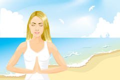 Girl meditating on the beach Stock Images