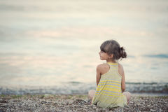 The girl meditating on the beach Royalty Free Stock Photography