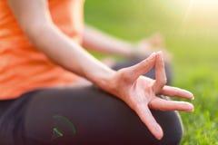 Girl meditating and doing yoga at sunset Stock Photos