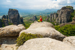 Girl meditating in Meteora, Greece Stock Photos