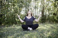 Girl meditating nature. Girl meditating in park with nature, relaxation Royalty Free Stock Images