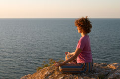 Girl meditating in padmasana Royalty Free Stock Photos