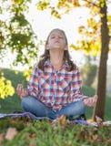 Girl meditating Stock Image