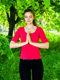 Girl meditating in park Royalty Free Stock Image