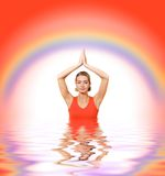 Girl meditating in water Royalty Free Stock Photo