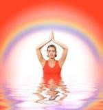 Girl meditating in water Royalty Free Stock Photo