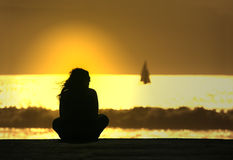 Girl in meditation. At sunset Royalty Free Stock Image