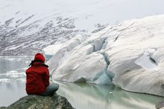 Girl in meditation. At Jostedalsbreen glacier Royalty Free Stock Image