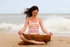 Girl meditation in beach Stock Image