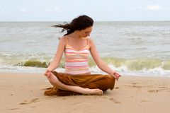 Girl meditation in the beach Stock Photography