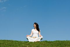 Girl meditation in grass royalty free stock photos