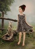 Girl and meerkat Stock Photos