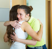 Girl meeting girlfriend at the door Royalty Free Stock Photography