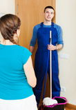 Girl meeting handsome cleaner Royalty Free Stock Photos