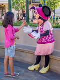 Girl meeting Minnie Mouse at Disney stock photography