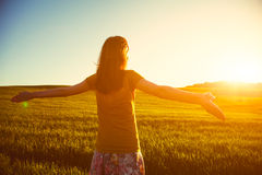 Girl meeting sunrise in morning Royalty Free Stock Photography