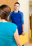 Girl meeting worker at the door Royalty Free Stock Photography