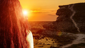 Girl meets sunset Royalty Free Stock Images