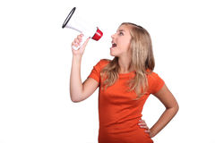 Girl with a megaphone. Spreading the word Stock Images