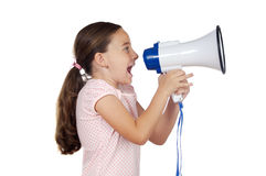 Girl with megaphone. Little girl shouting through megaphone over white background Royalty Free Stock Image