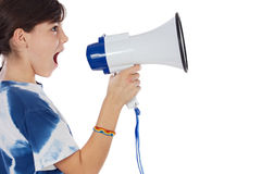 Girl with megaphone. Girl shouting through megaphone over white background Stock Image