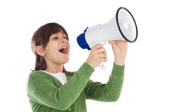 Girl with megaphone. Little girl shouting through megaphone over white background Royalty Free Stock Images