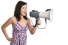 Girl with a megaphone. Isolated,studio shot Stock Images