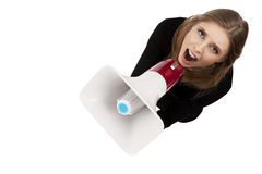 Girl with megaphone. Isolated on a white background Stock Image