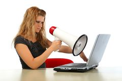 Girl with megaphone med about computer Royalty Free Stock Photos